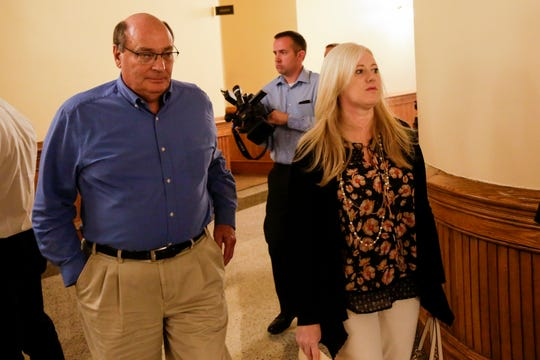 Kristine Barnett walks out of the magistrate courtroom with an unidentified man after an initial hearing, Friday, Sept. 27, 2019 at the Tippecanoe County Courthouse in Lafayette. Barnett and her ex-husband, Michael Barnett, are accused of abandoning their adoptive daughter in Lafayette in 2013.
