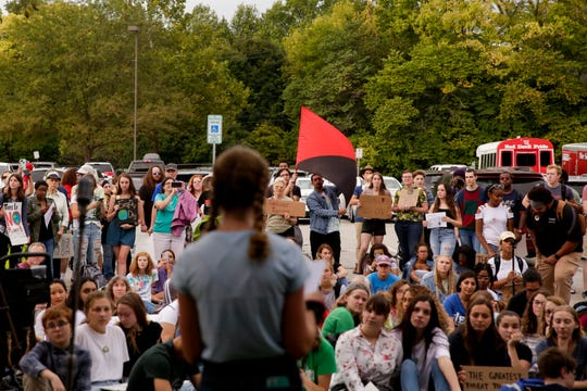 Annabel Prokopy, a West Lafayette student, speaks during a climate strike rally outside Happy Hollow School, Friday, Sept. 27, 2019, in West Lafayette. About 300 students and community members marched from West Lafayette Jr./Sr. High School to the West Lafayette library and then to Happy Hollow School calling for climate change action.