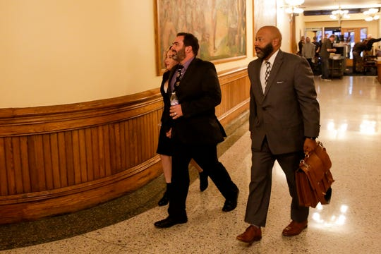 Michael Barnett and attorney Terrance Kinnard walk into the magistrate courtroom for an initial hearing before Judge Steven Meyer, Friday, Sept. 27, 2019 at the Tippecanoe County Courthouse in Lafayette. Barnett and his ex-wife, Kristine Barnett, are accused of abandoning their adoptive daughter in Lafayette in 2013.