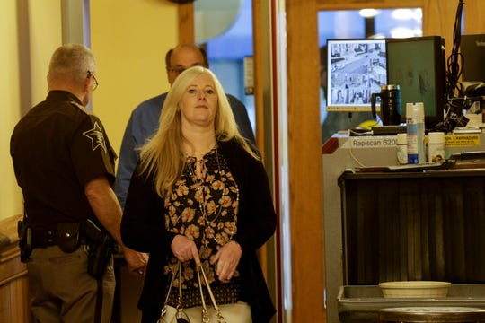 Kristine Barnett walks into the magistrate courtroom for an initial hearing, Friday, Sept. 27, 2019 at the Tippecanoe County Courthouse in Lafayette. Barnett and her ex-husband, Michael Barnett, are accused of abandoning their adoptive daughter in Lafayette in 2013.