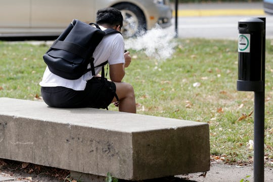 A person uses a electronic cigarette at Purdue University, Friday, Sept. 27, 2019, in West Lafayette.