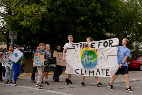 Students and community members march to Happy Hollow School during climate change strike, Friday, Sept. 27, 2019, in West Lafayette. About 300 students and community members marched from West Lafayette Jr./Sr. High School to the West Lafayette library and then to Happy Hollow School calling for climate change action.