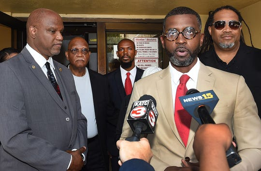 Harry Daniels, a lawyer defending former Opelousas Mayor Reggie Tatum, holds a press conference Friday outside the court after judge rules Tatum is guilty of all charges of malfeasance and forgery. Tatum, left, stands next to his brother, Butch, and to far right is Rod Sias, former administrative assistant to the mayor.