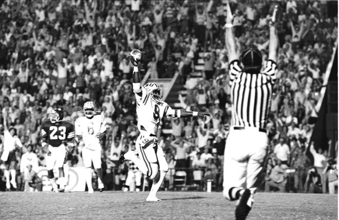 LSU running back LeRoid Jones scores on a 13-yard pass from quarterback Steve Ensminger (now LSU's offensive coordinator) for a 6-3 lead over No. 1 USC in the second quarter on Sept. 29, 1979, in Tiger Stadium.