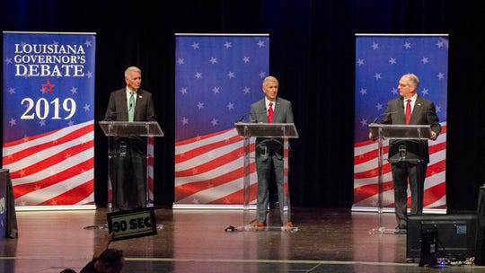 A gubernatorial debate with candidates, from left, U.S. Rep. Ralph Abraham, businessman Eddie Rispone and Gov. John Bel Edwards is held on the University of Louisiana at Lafayette campus Thursday, Sept. 26, 2019.
