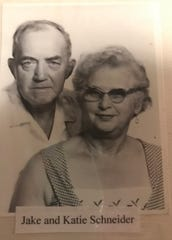 A photo of Jake and Katie Schneider, who owned what's now Stober's bar from 1935 to 1958, is included in a history scrapbook at the bar Sept. 23, 2019.