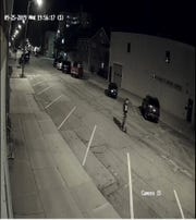 Still image from surveillance video that Manitowoc police said shows a person of interest in a vandalism case.