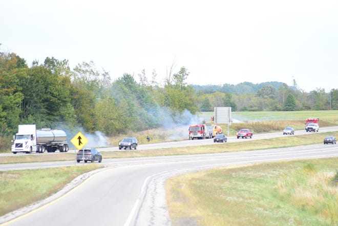 Firefighters work to extinguish several fires along the westbound lanes of U.S. 30 near Crestline.