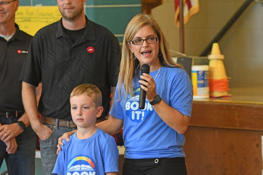 Western Elementary principal Genelle Eggerton announces first grade student Patrick Smith was a nationwide winner in the Book It contest. X
