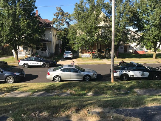 Police searched a house in the 400 block of Sherman Place and arrested a man who was charged with having weapons while under disability.