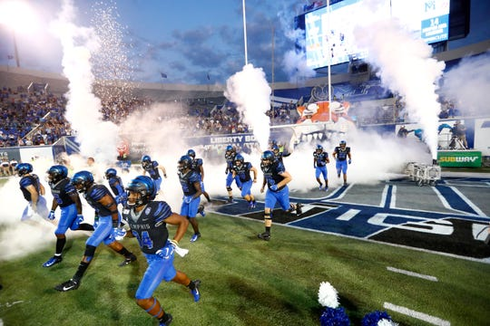 Memphis Tigers players take the field to play Navy at the Liberty Bowl Memorial Stadium on Thursday, September 26, 2019.