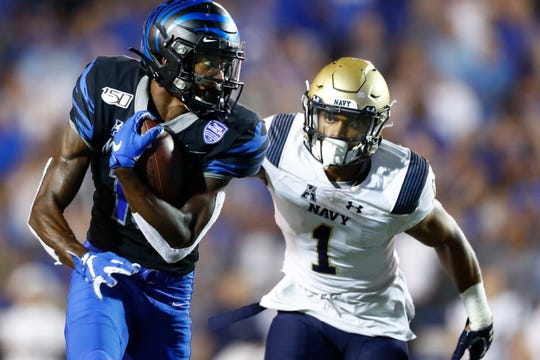 Memphis Tigers wide receiver Damonte Coxie looks back at Navy defender Jacob Springer as he runs in a 31-yard touchdown during their game at the Liberty Bowl Memorial Stadium on Thursday, September 26, 2019.