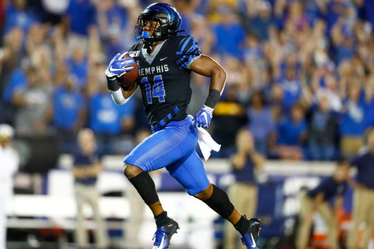 Memphis Tigers wide receiver Antonio Gibson catches a 73-yard touchdown against Navy during their game at the Liberty Bowl Memorial Stadium on Thursday, September 26, 2019.