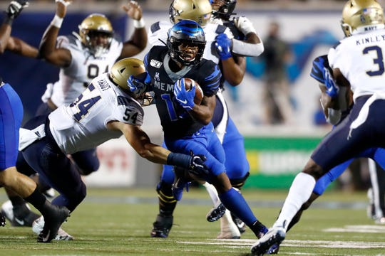 Memphis Tigers running back Kenneth Gainwell breaks past Navy linebacker Diego Fagot during their game at the Liberty Bowl Memorial Stadium on Thursday, September 26, 2019.