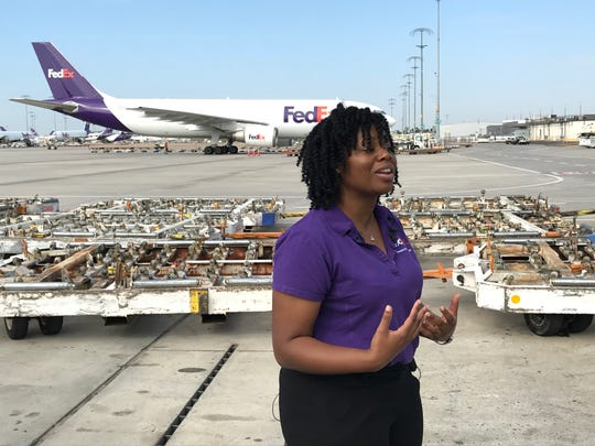 FedEx Express employee Phalisha Jackson talks with Memphis media members about holiday hiring opportunities at the FedEx Express World Hub.