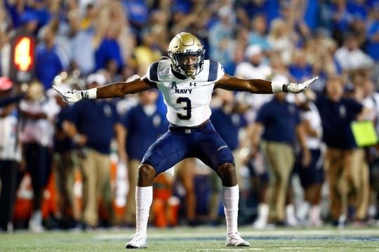 Navy special teams defender Cameron Kinley celebrates a missed field goal by the Memphis Tigers during their game at the Liberty Bowl Memorial Stadium on Thursday, September 26, 2019.