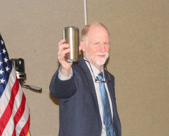 Fred Clark of Madison holds a mug given to him Wednesday, Sept. 25 as he ended his brief tenure on the Wisconsin Natural Resources Board. Clark resigned out of a desire to avoid conflict of interests between his board position and his job as executive director of Wisconsin's Green Fire. He had been appointed to the board in February by Gov. Tony Evers.