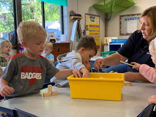 Preschool teacher Kathy Dahm helps (from left) Ryder, Rory and Charlotte pick out blocks during the activity session following afternoon naptime at KinderCare's Pine Street facility in Waukesha. KinderCare is among the most prevalent daycare centers in Waukesha and Milwaukee counties, with 23 locations.