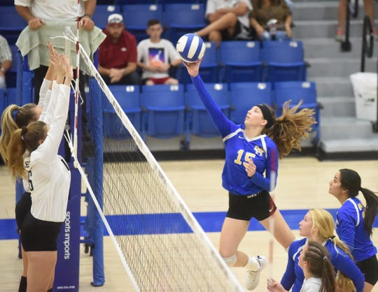 Mountain Home's Kylee Sabella tips the ball during a recent home match. The Lady Bombers posted a three-set sweep at Paragould on Thursday night.