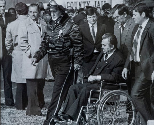 Alva Lambert is seen in a photo with Governor George Wallace at the funeral of Paul Bear Bryant.