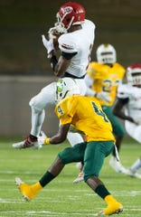 Lee's Jamari Smith (3) catches a pass at Cramton Bowl in Montgomery, Ala., on Thursday, Sept. 26, 2019. Lee leads Carver 28-7 at halftime.