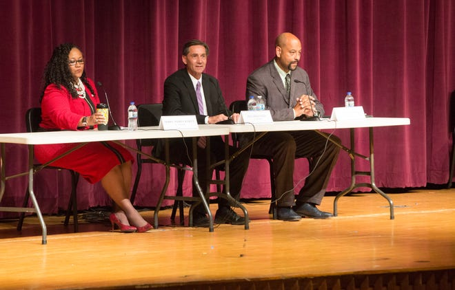 Candidates prepare to address the crowd gathered during the mayoral candidate forum on Sept. 27 at Central High School.