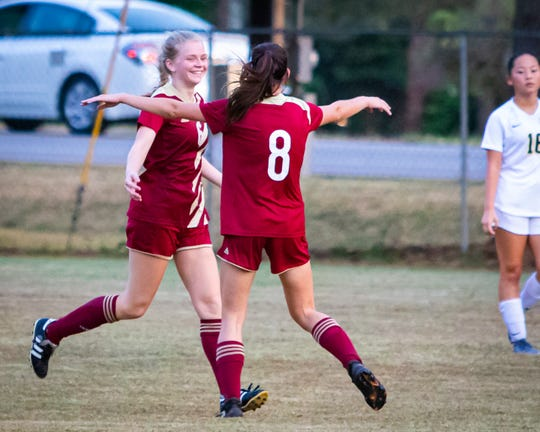 Troi Martin and Jenna Wyckoff celebrate Martin's goal, the second for the Lady Warriors.