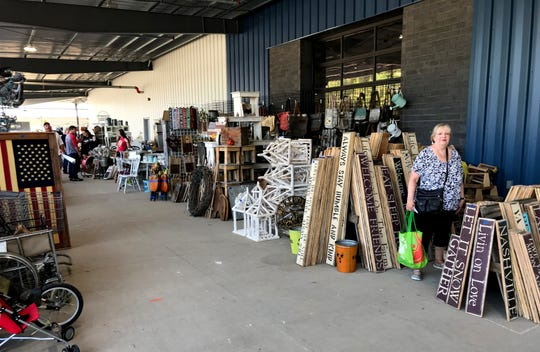 Sylvia Franks, of Antioch, checks out one of the vendors in the outdoor area of the new Nashville Flea Market Sept. 27, 2019.