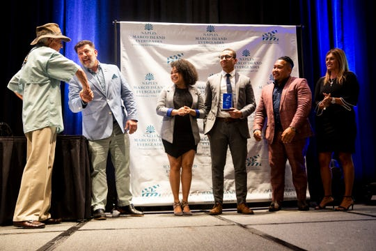 Innovation Star winners from Food Idea Group, Guy Clarke II, Vanessa Fernandez, Melvin Silverio, and Rafael Feliciano accept their award during the Paradise Coast Tourism Star Awards at the Naples Grande Resort in Naples on Friday, September 27, 2019.