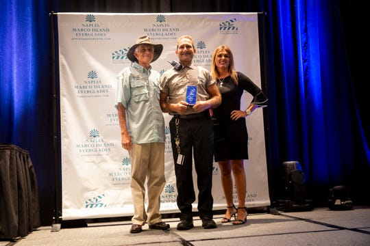 Hotel Service Star winner Juan Jimenez poses for a photo during the Paradise Coast Tourism Star Awards at the Naples Grande Resort in Naples on Friday, September 27, 2019.