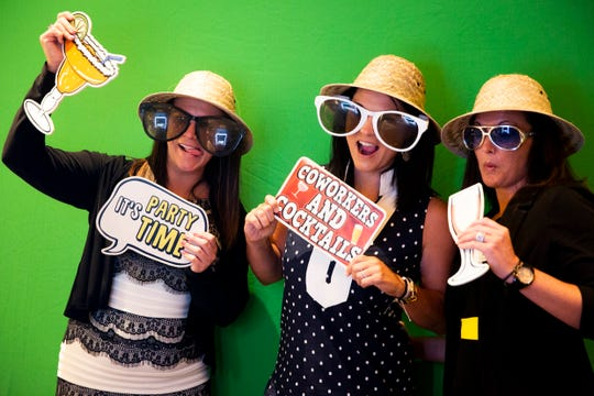 From left to right, Kika Bukowski, Jenny Gezella, and Kendra Bisek pose for a photo booth picture during the Paradise Coast Tourism Star Awards at the Naples Grande Resort in Naples on Friday, September 27, 2019.