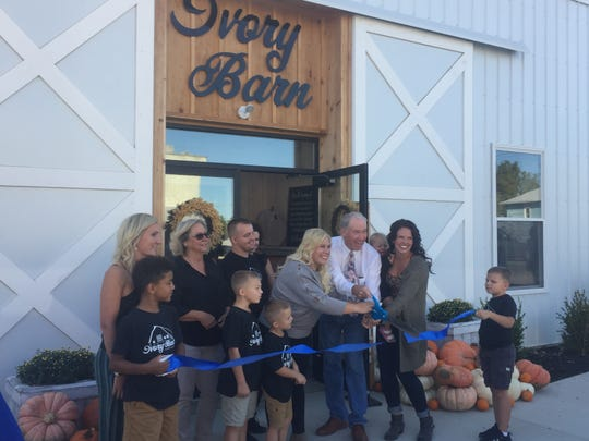Mayor Mike Compton helped cut the ribbon, officially opening the Ivory Barn in downtown Pataskala Sept. 26.