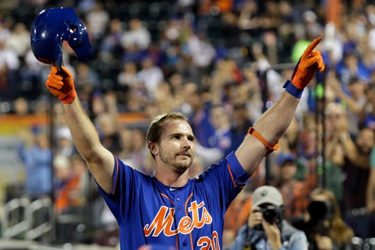 New York Mets' Pete Alonso takes a curtain call after hitting his 52nd home run of the season during the first inning of a baseball game against the Atlanta Braves, Friday, Sept. 27, 2019, in New York. (AP Photo/Adam Hunger)
