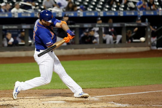 New York Mets' Pete Alonso hits his 52nd home run of the season during the first inning of a baseball game against the Atlanta Braves, Friday, Sept. 27, 2019, in New York. (AP Photo/Adam Hunger)