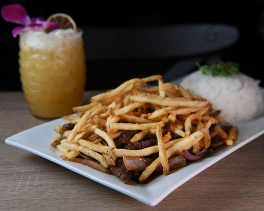 Lomo Saltado and a Yucama Mishu drink at Nazca on Thursday, September 26, 2019.