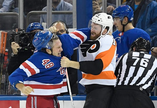 Sept. 26, 2019; New York, NY, USA; New York Rangers left wing Brendan Lemieux (48) throws punches with Philadelphia Flyers center Sean Couturier (14) during the first period at Madison Square Garden.