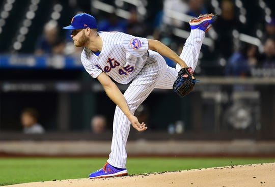 Starting pitcher Zack Wheeler of the New York Mets follows through with a pitch in the first inning of their game against the Miami Marlins at Citi Field on September 26, 2019 in New York. This may be Wheeler's final game as a Met with his contract coming to an end.