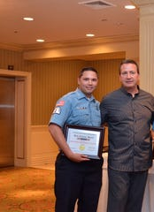 Dispatcher and special police officer Christopher Delucca and Chief Richard Gaito at an awards night in 2016.