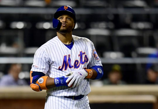 Robinson Cano #24 of the New York Mets reacts after being struck by a pitch in the eighth inning of their game against the Miami Marlins at Citi Field on September 26, 2019 in New York.