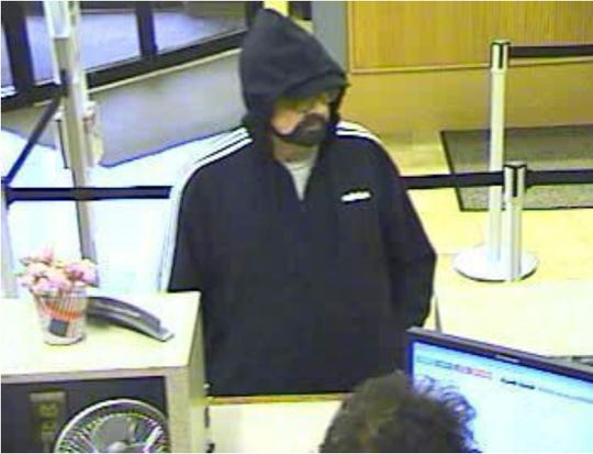 The suspect in a bank robber at the bank robbery that occurred at the Wells Fargo Bank on Route 23 in Pequannock was last seen wearing dark colored pants, a dark colored hooded Adidas sweatshirt with white stripes on the arms, a dark colored ball cap, and glasses.