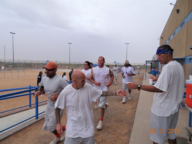 Inmates from MTC Corporation Otero County Prison Facility donated $300 to the families of the El Paso's victims by participating in a marathon on Saturday, Sept. 21.