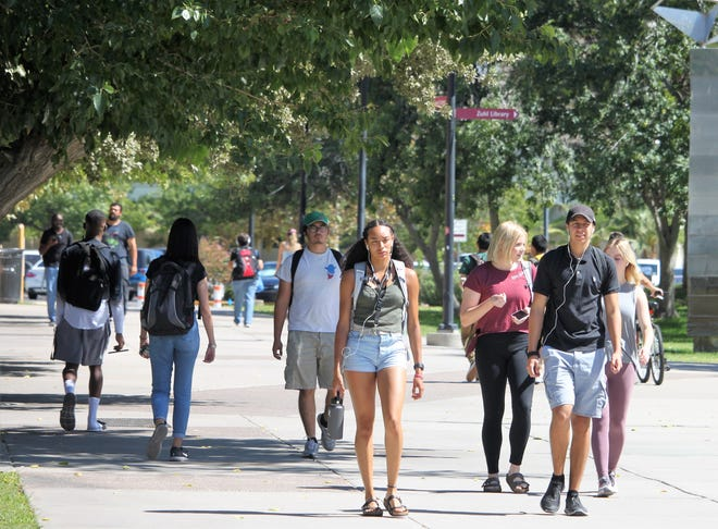 Students navigate New Mexico State University's main campus in Las Cruces on Friday, Sept. 27, 2019.