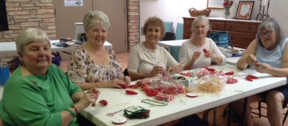 Las Colcheras Guild Members, Chris Ramsey, Deb Moon, Sharon Ogle, Nancy Carson and Kris Northcutt working on ornaments for the 2019 US Capitol Christmas Tree Project.