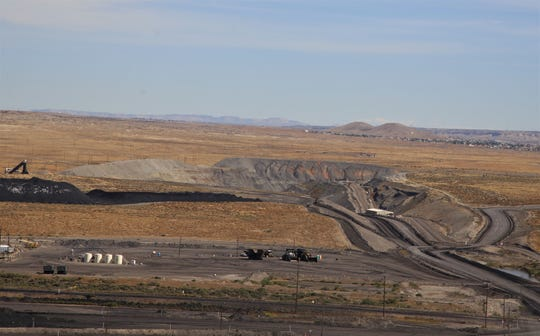 The San Juan Mine is pictured, Wednesday, Sept. 25, 2019, from the San Juan Generating Station in Waterflow. Unlike the nearby Navajo Mine, the San Juan Mine has been transformed into an underground mine after initially being a surface mine.
