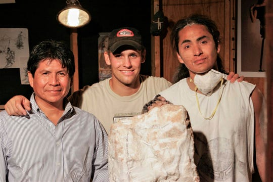 "Director Travis Hamilton, center, is pictured on the set of his film ""Turquoise Rose"" with actors Deshava Apachee, left, and Oreland C. Joe."