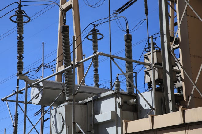 A transformer is pictured just outside the San Juan Generating Station. The transformer increases the voltage prior to transporting it away from the power plant.