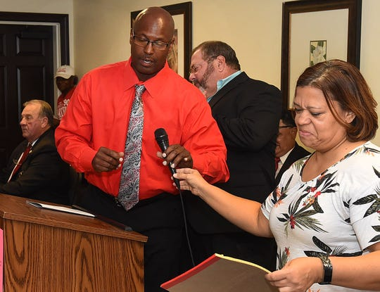 Carl Hardy, an Oct. 12 candidate for St. Landry Parish Sheriff approaches the podium Thursday night during an election forum sponsored by the Family Strong Foundation. Sheriff candidates Bobby Guidroz and Paul Dicapo can be seen in the background. The event was held at the Evangeline Downs Hotel in Opelousas.