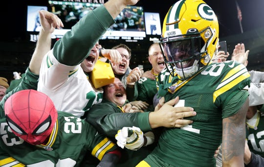 Green Bay Packers wide receiver Geronimo Allison (81) takes a Lambeau leap after scoring a touchdown against the Philadelphia Eagles during their football game Thursday, September 26, 2019, at Lambeau Field in Green Bay, Wis. The Eagles defeated the Packers 34 to 27.