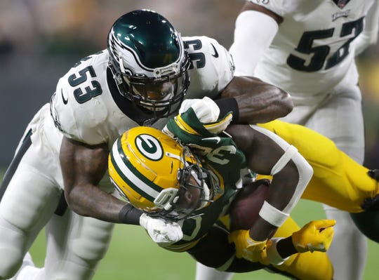 Philadelphia Eagles outside linebacker Nigel Bradham (53) tackles Green Bay Packers running back Jamaal Williams (30), injured on the play, during their football game Thursday, September 26, 2019, at Lambeau Field in Green Bay, Wis.