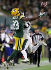 Philadelphia Eagles defensive back Johnathan Cyprien (37) is called for pass interference while defending Green Bay Packers wide receiver Marquez Valdes-Scantling (83) during their football game Thursday, September 26, 2019, at Lambeau Field in Green Bay, Wis. The Eagles defeated the Packers 34 to 27.